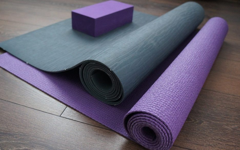 two yoga mats on a wood floor